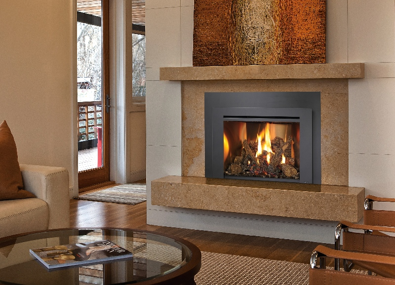 Image of an efficient Gas insert made by FireplaceX featuring a realistic wood log set.
