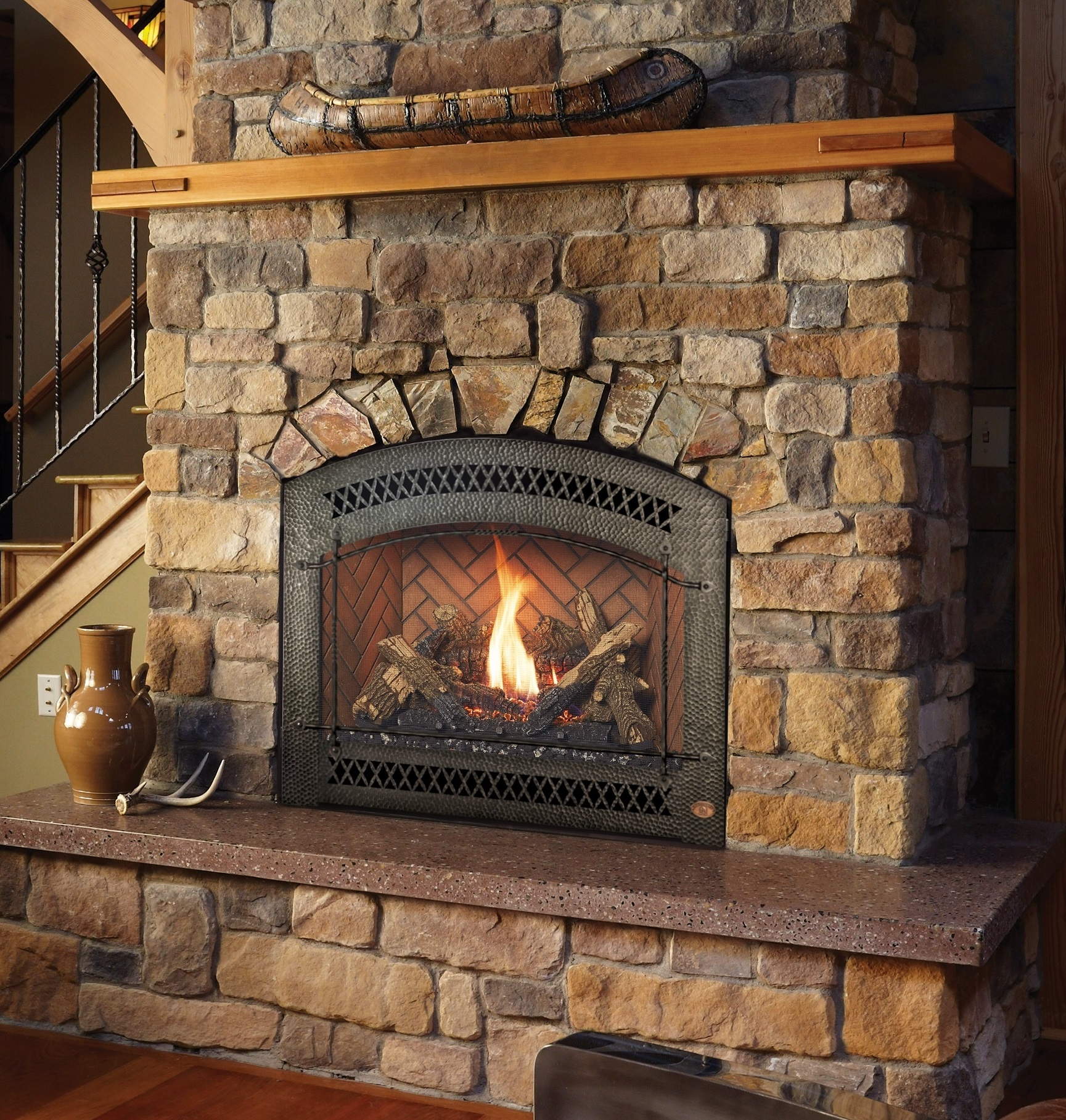 Image of the sleek  864 HO Gas Fireplace made by FireplaceX featuring a realistic stone set with glass media.