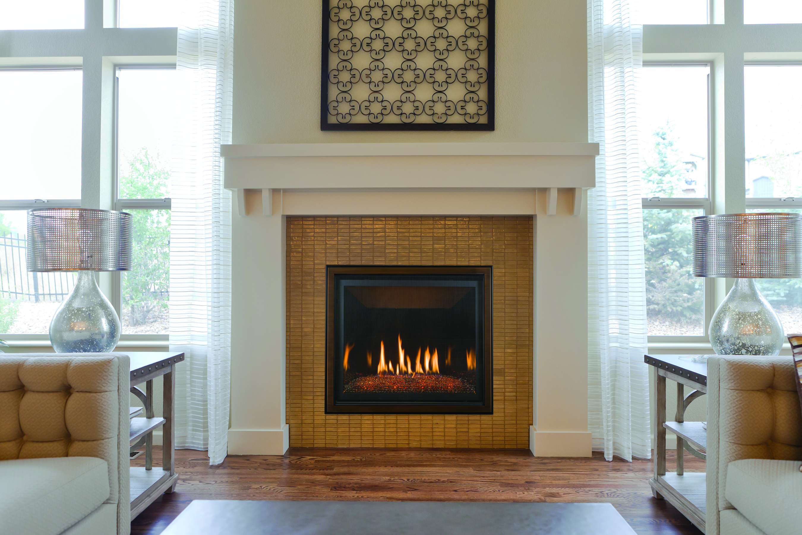 Image of the modern Bayport 36 gas fireplace made by KozyHeat featuring a rustic wood logset and old world brick fire backing.
