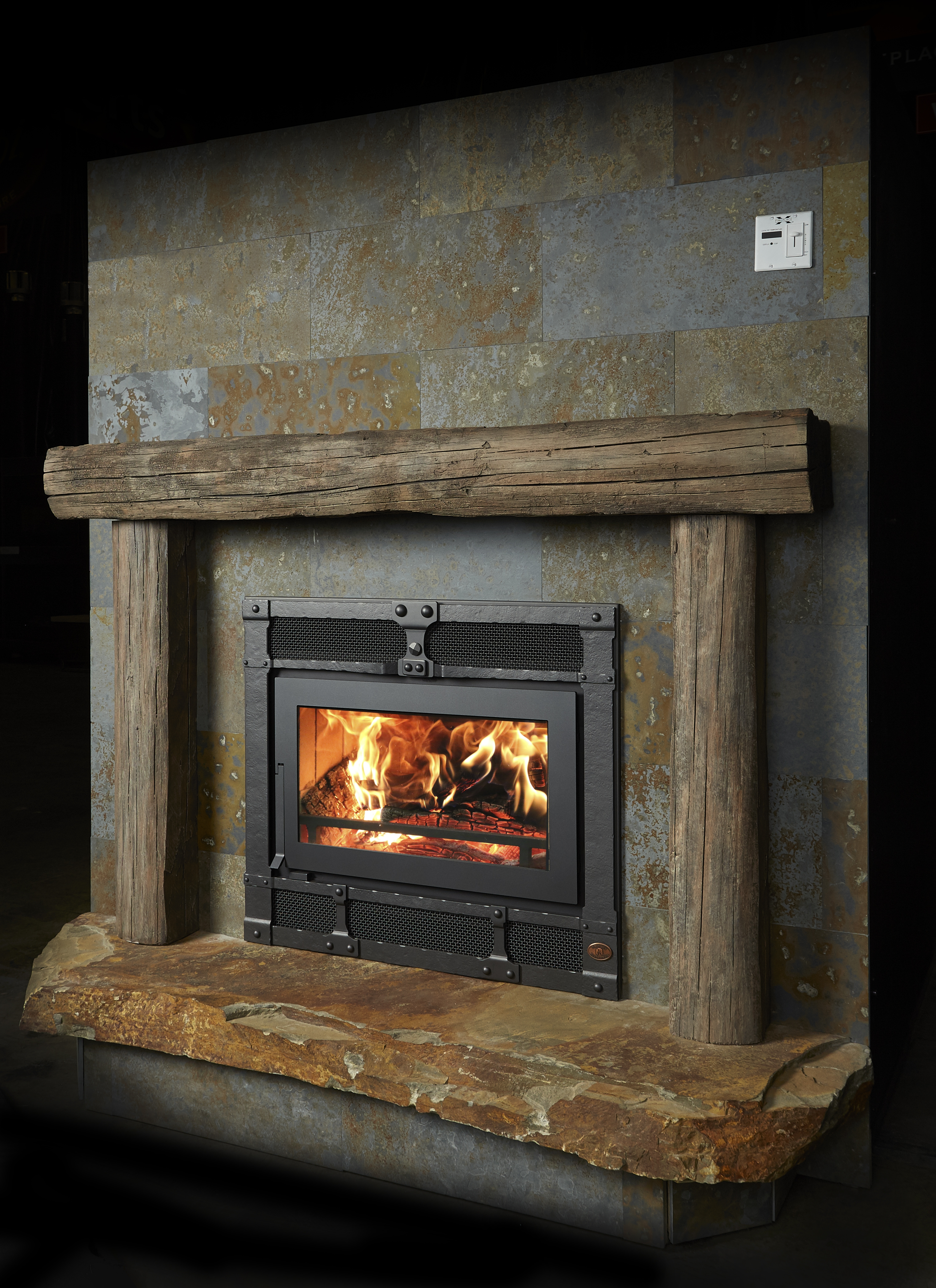 Image of the modern 42 Apex woodburning fireplace featuring a traditional face.