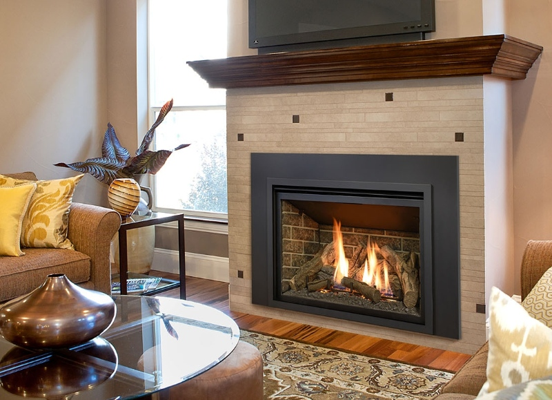 Image of the beautiful Chaska 34 L Gas insert made by KozyHeat featuring a realistic fireplace.