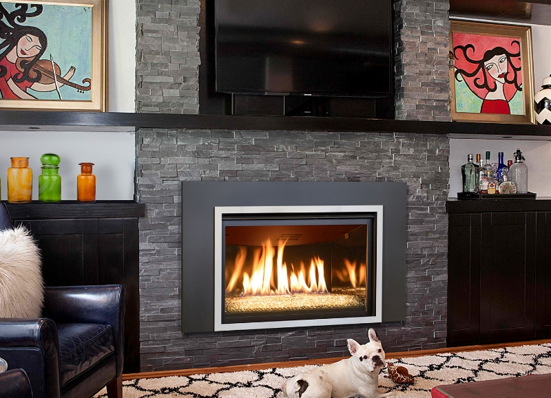 Image of the beautiful Chaska 34 G Gas insert made by KozyHeat featuring a realistic fireplace.