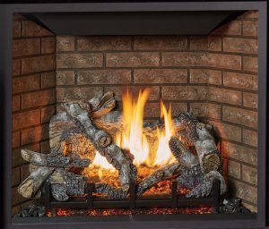 This is an image of a traditional ProBuilder 36 CF gas fireplace by Fireplace X featuring birch oak log set and common brick interior