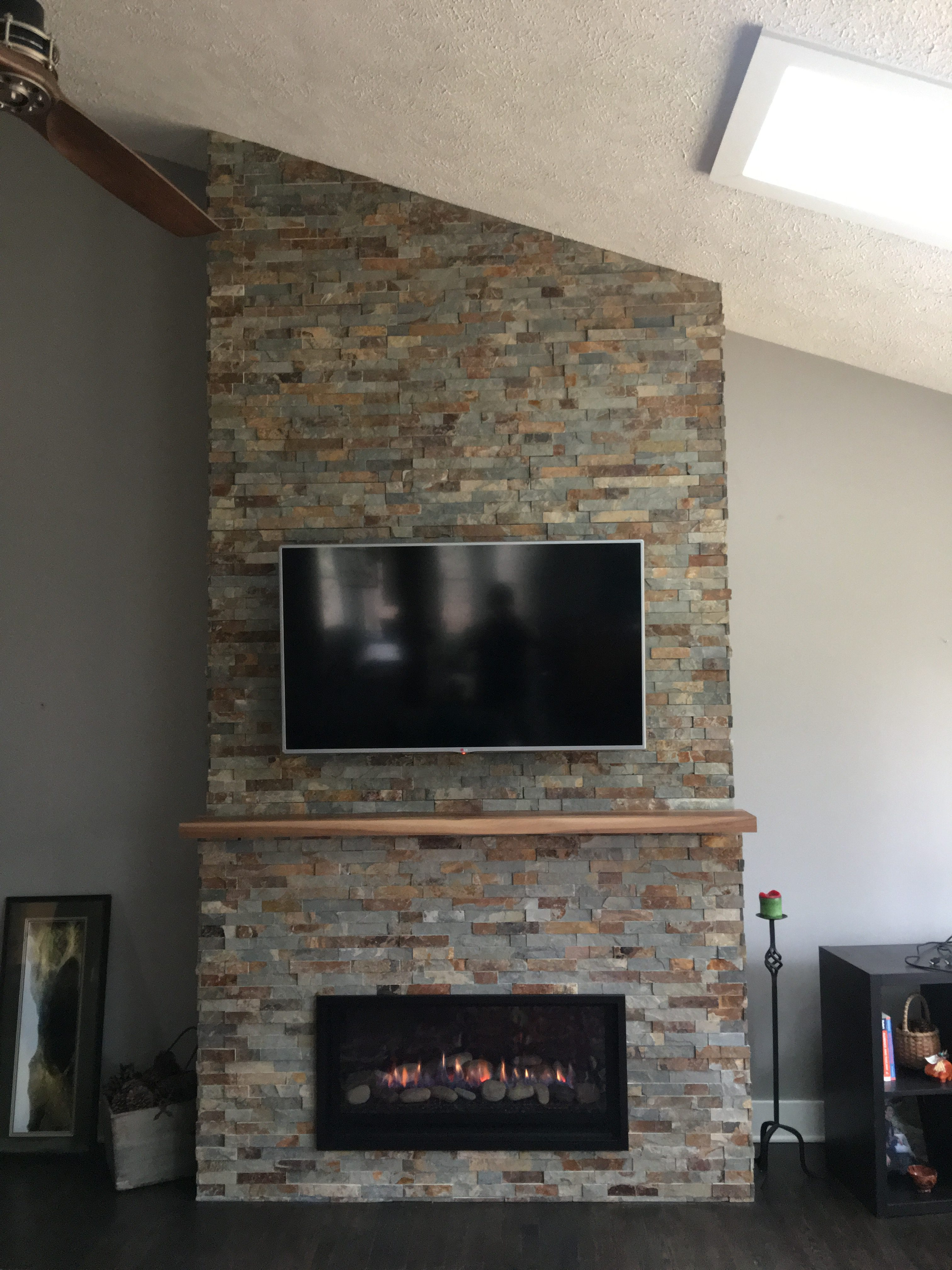 Image of a contemporary Slayton 36 by Kozy Heat featuring stonework facing.