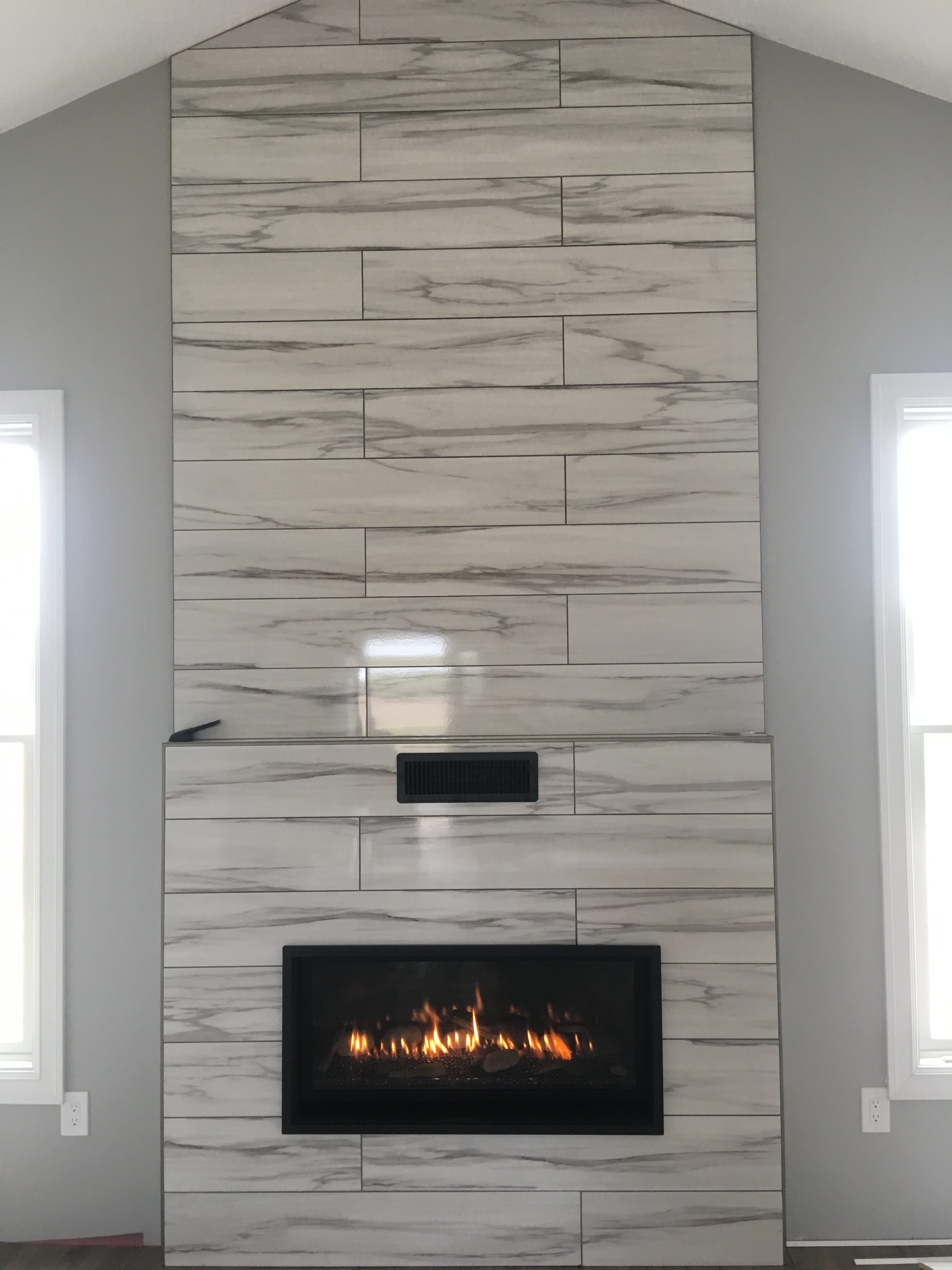 Image of a contemporary Slayton 42 by Kozy Heat featuring sleek large format tile facing.