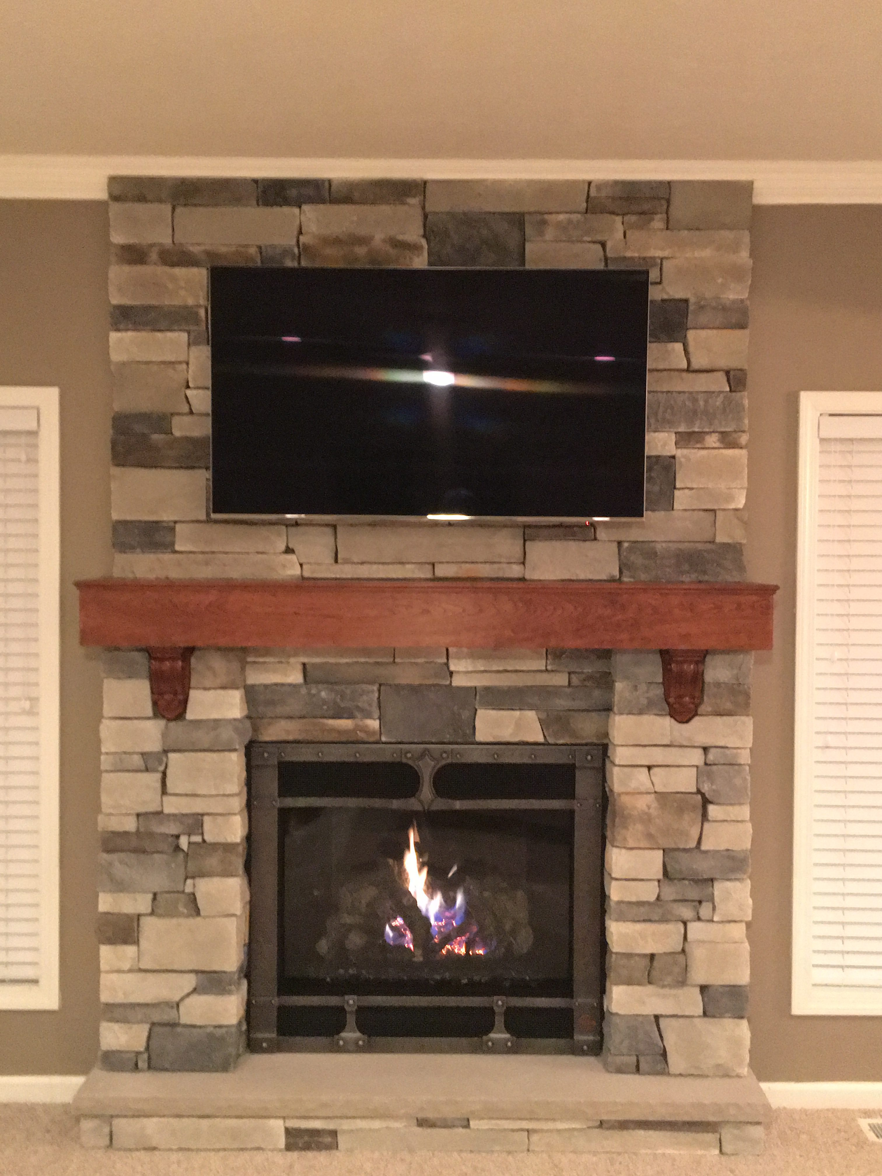 Image of a traditional 864TRV gas fireplace by Fireplace X featuring rustic stonework and mantle.