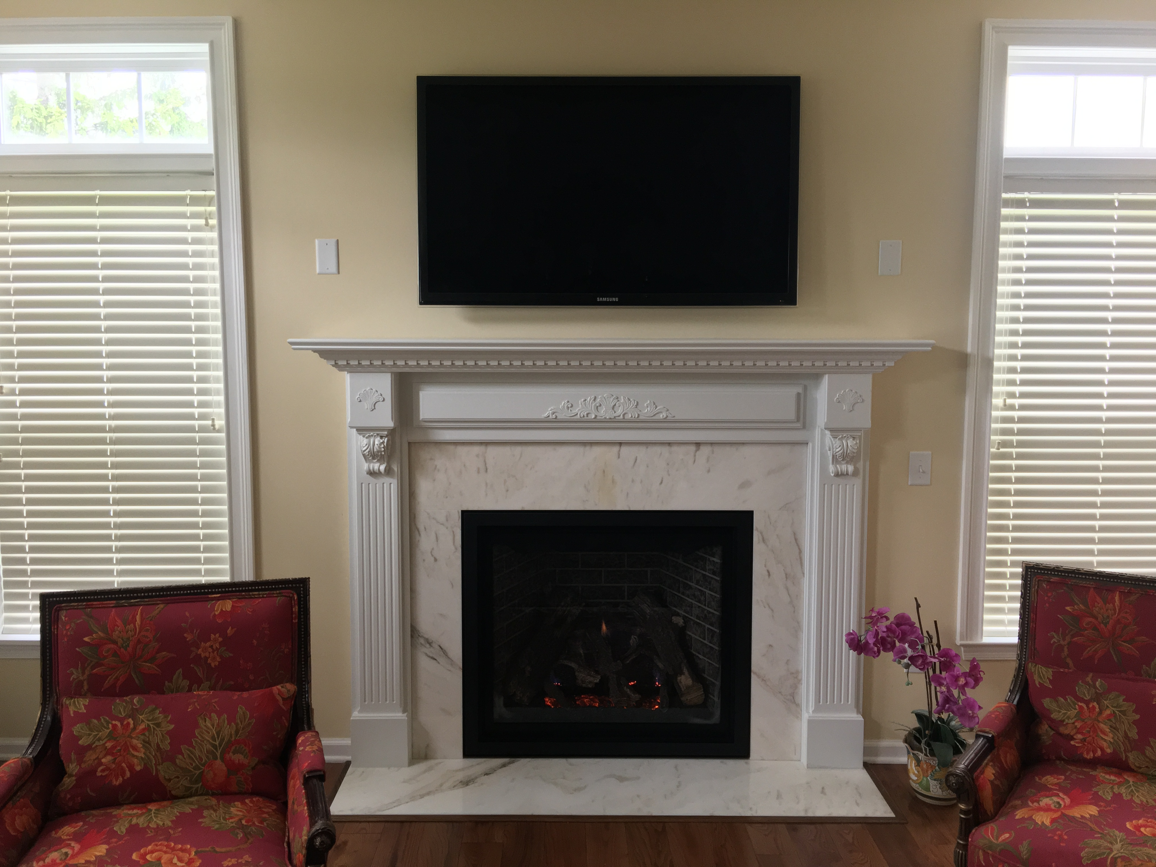 Image of a traditional Carlton 39 gas fireplace by Kozy Heat featuring traditional granite facing and mantle.