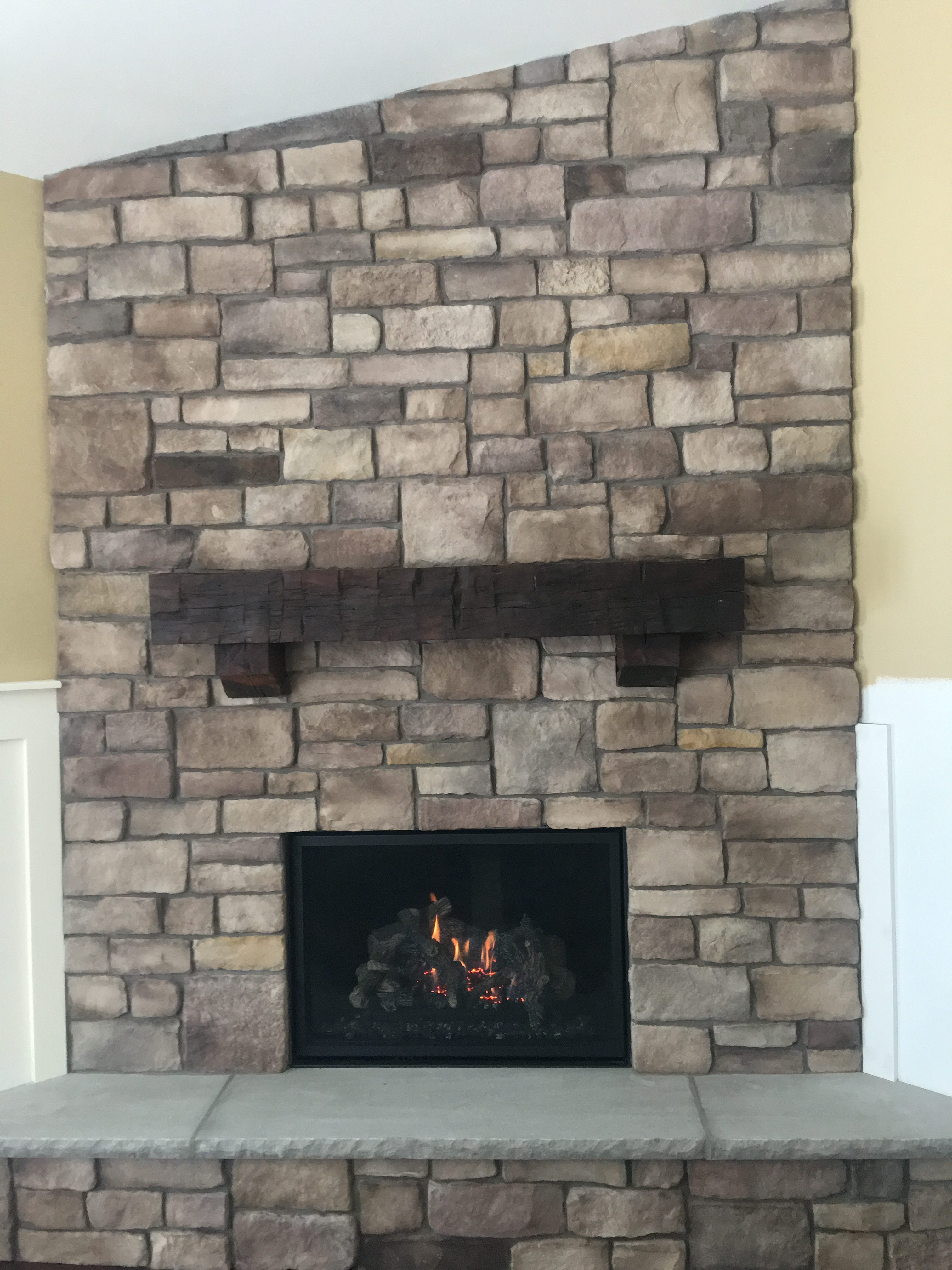 Image of a traditional 864TRV CleanFace gas fireplace by Travis Industries featuring stone facing and mantle.