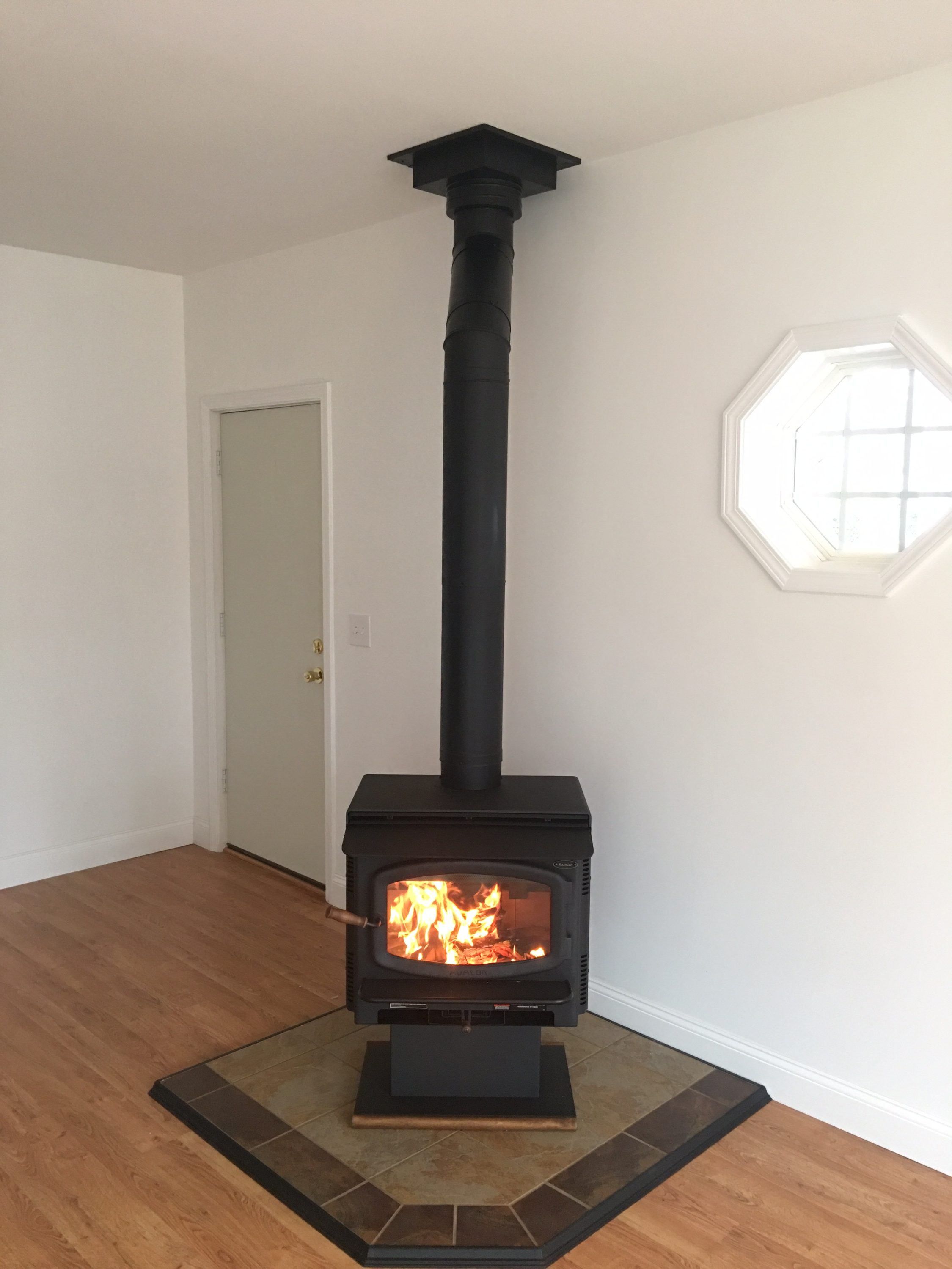 Image of a Rainier Wood Stove by Travis Industries featuring Desert Canyon Hearth Pad.