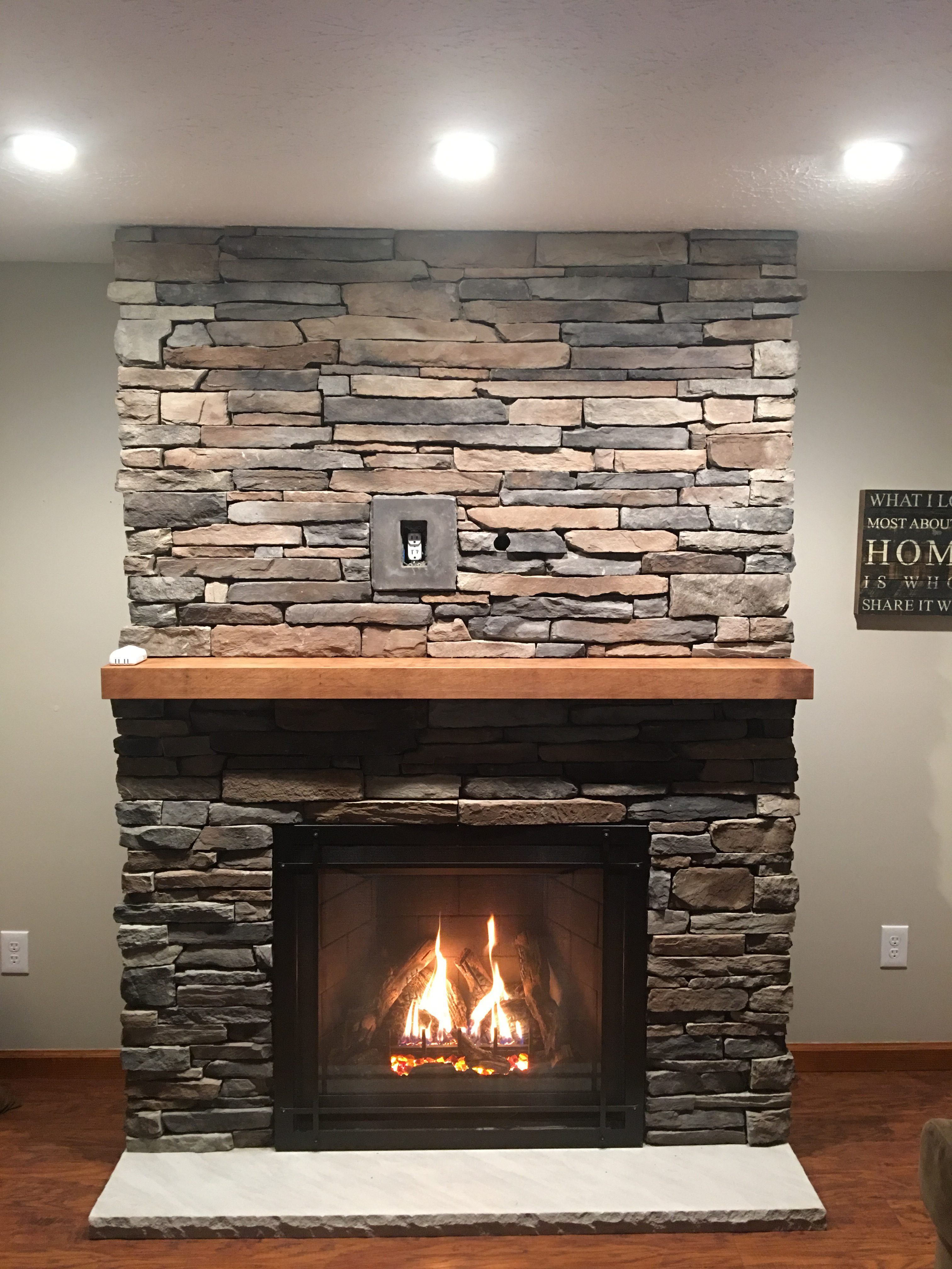 Image of a traditional Bayport 36-L gas fireplace by Kozy Heat featuring stone facing and mantle.