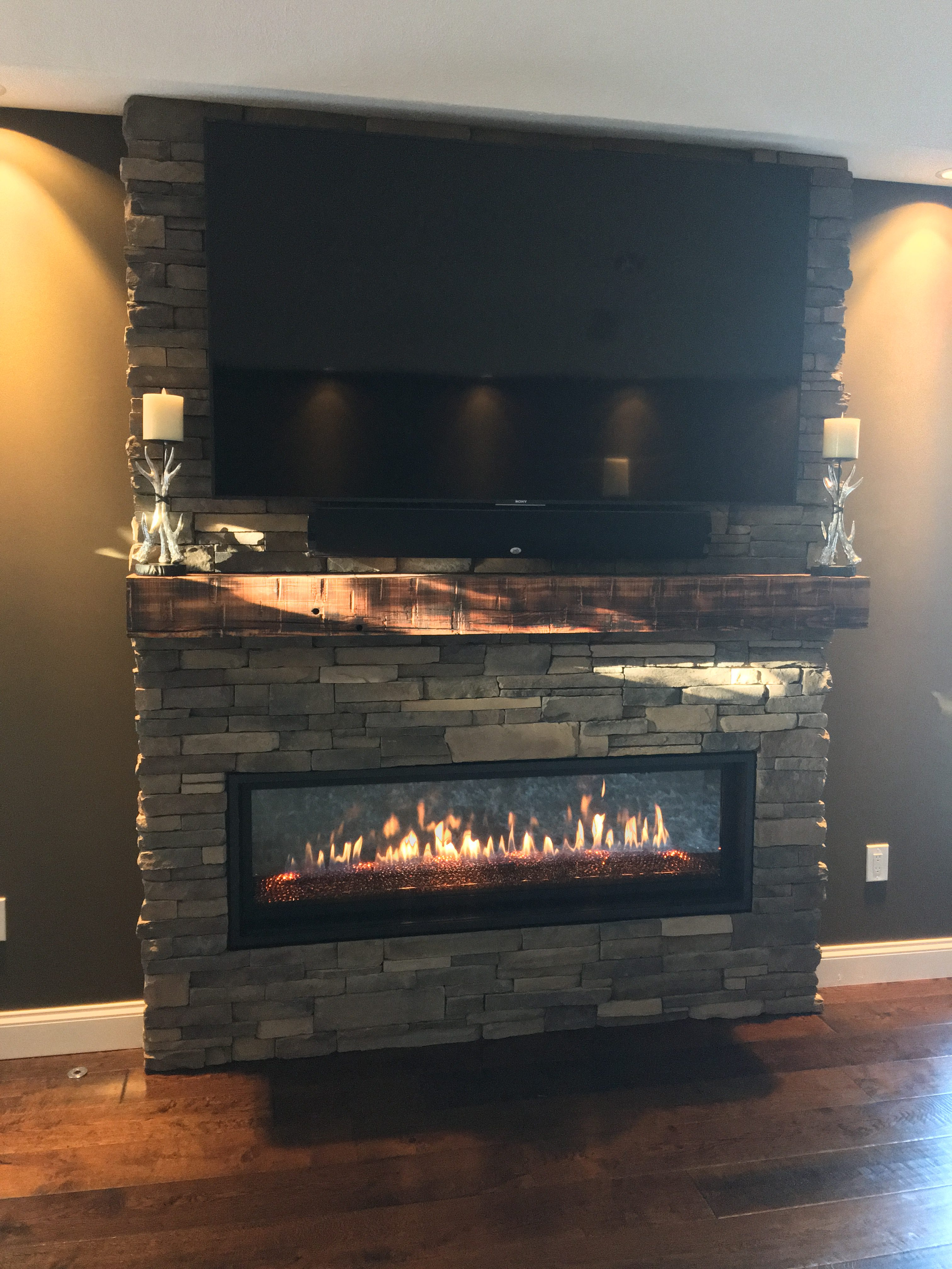 Image of a contemporary Slayton 60 by Kozy Heat featuring rustic stonework facing and mantle.