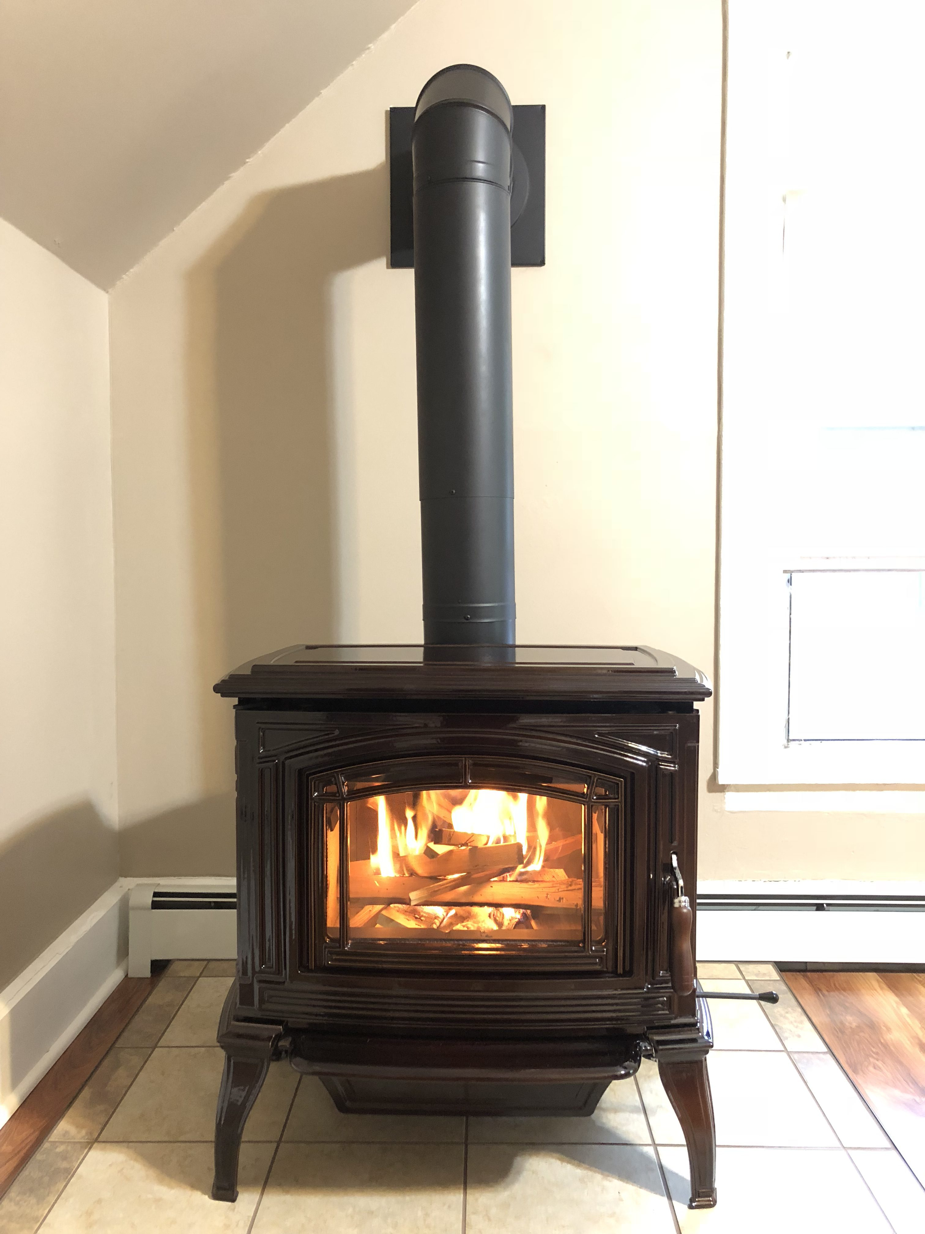 Image of a traditional Boston 1700 wood stove by Enviro featuring sleek Antique Chestnut Enamel Finish.