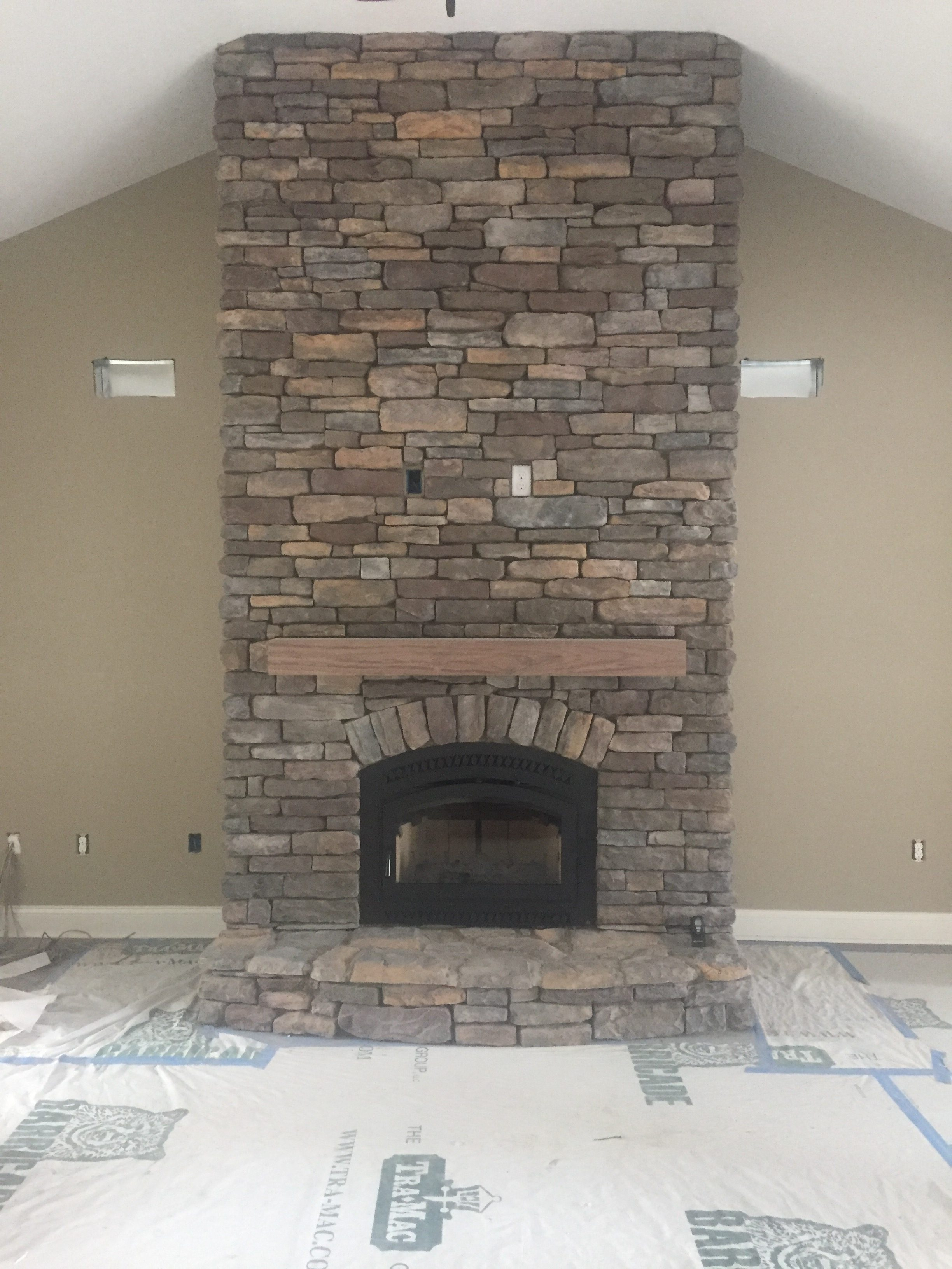 Image of a traditional 36 Elite Wood fireplace by Travis Industries featuring stone facing and mantle.