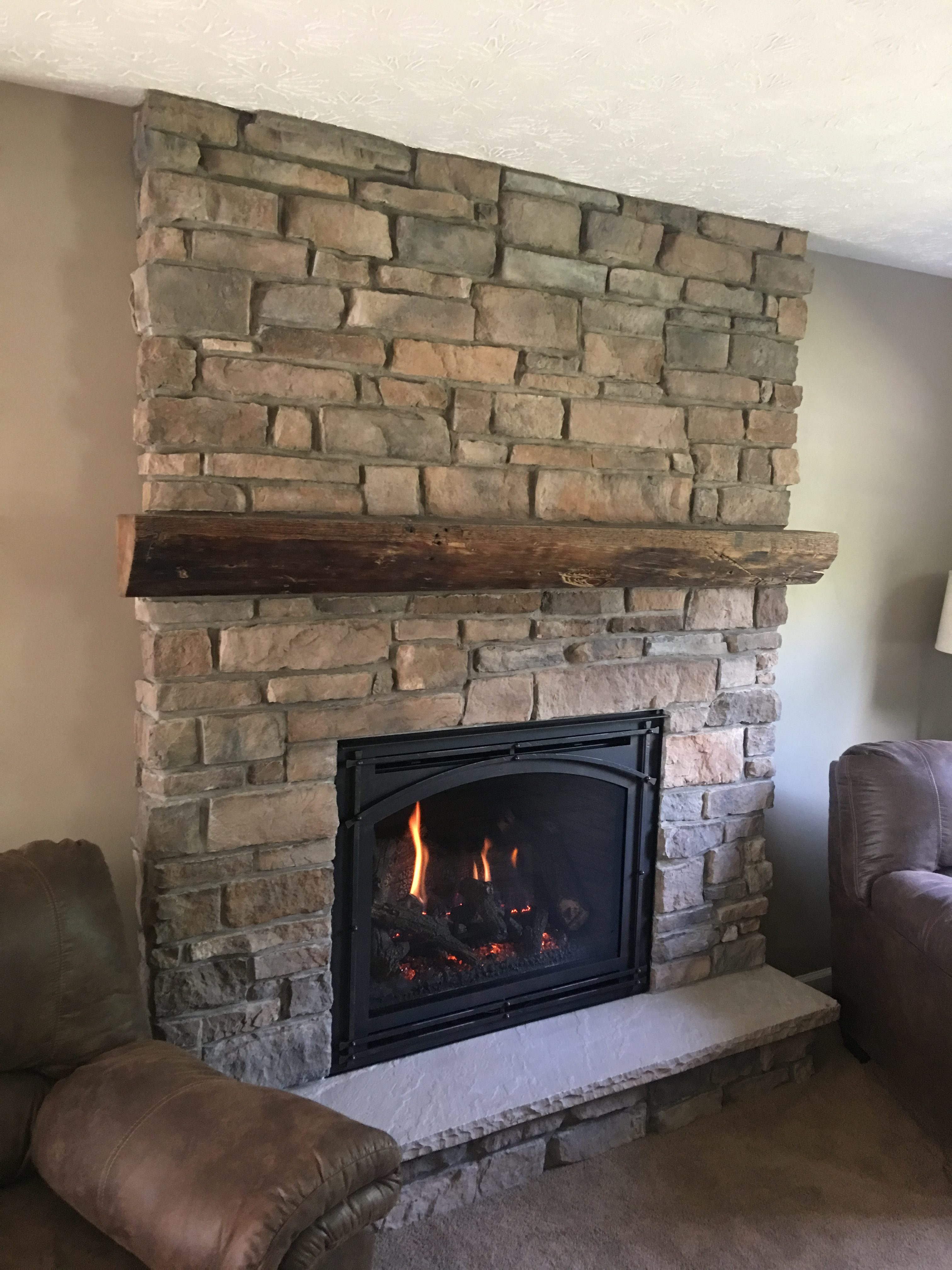 Image of a traditional Springfield 36 gas fireplace by Kozy Heat featuring stone facing .