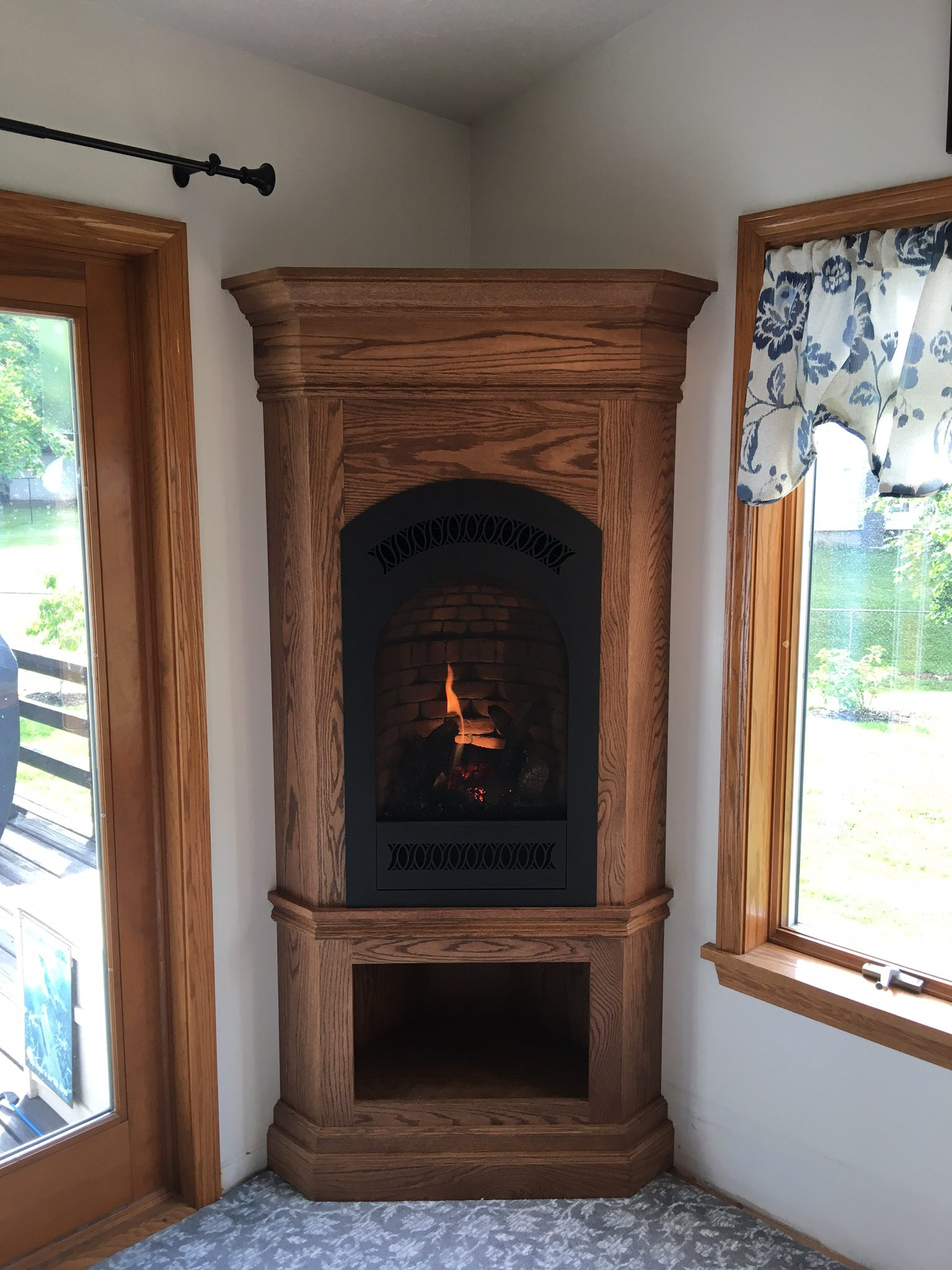 Image of a traditional 21TRV portrait gas fireplace by Travis Industries and J.C. Huffman Custom Cabinet.