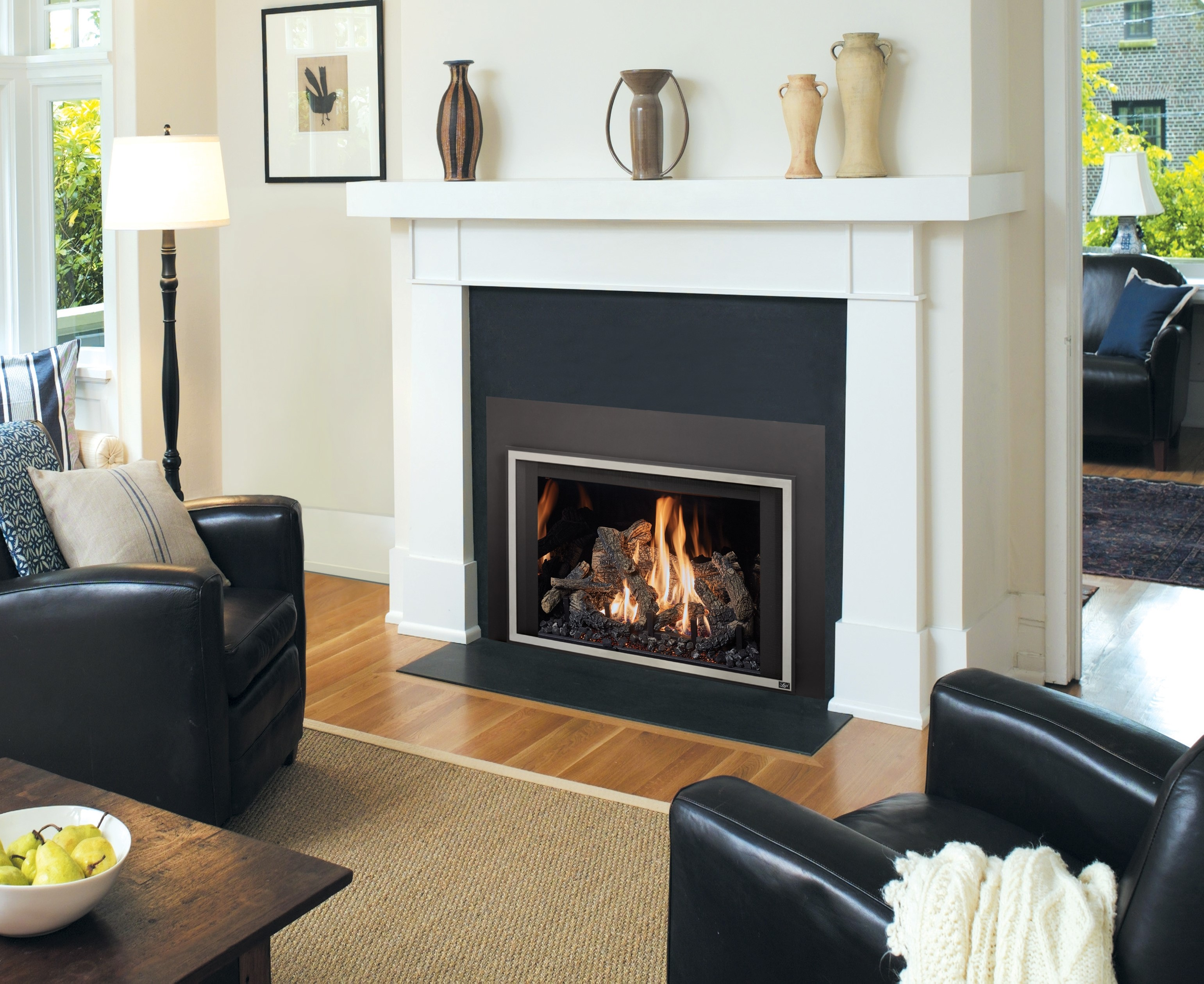 Image of an efficient Gas insert made by Travis Industries featuring a realistic wood log set.