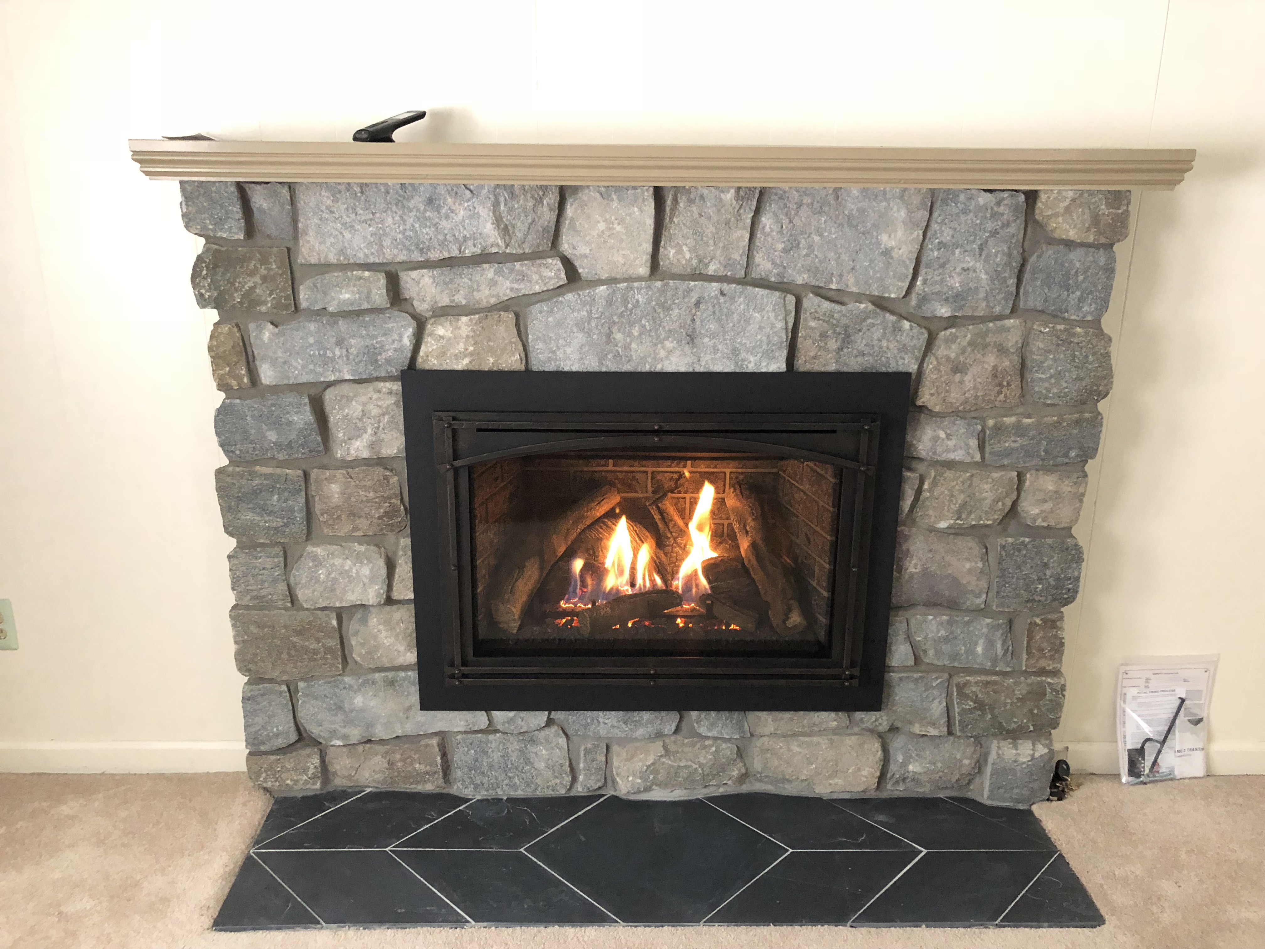 Image of a Chaska 34-L gas insert by Kozy Heat featuring Traditional Brick Interior and stone facing.