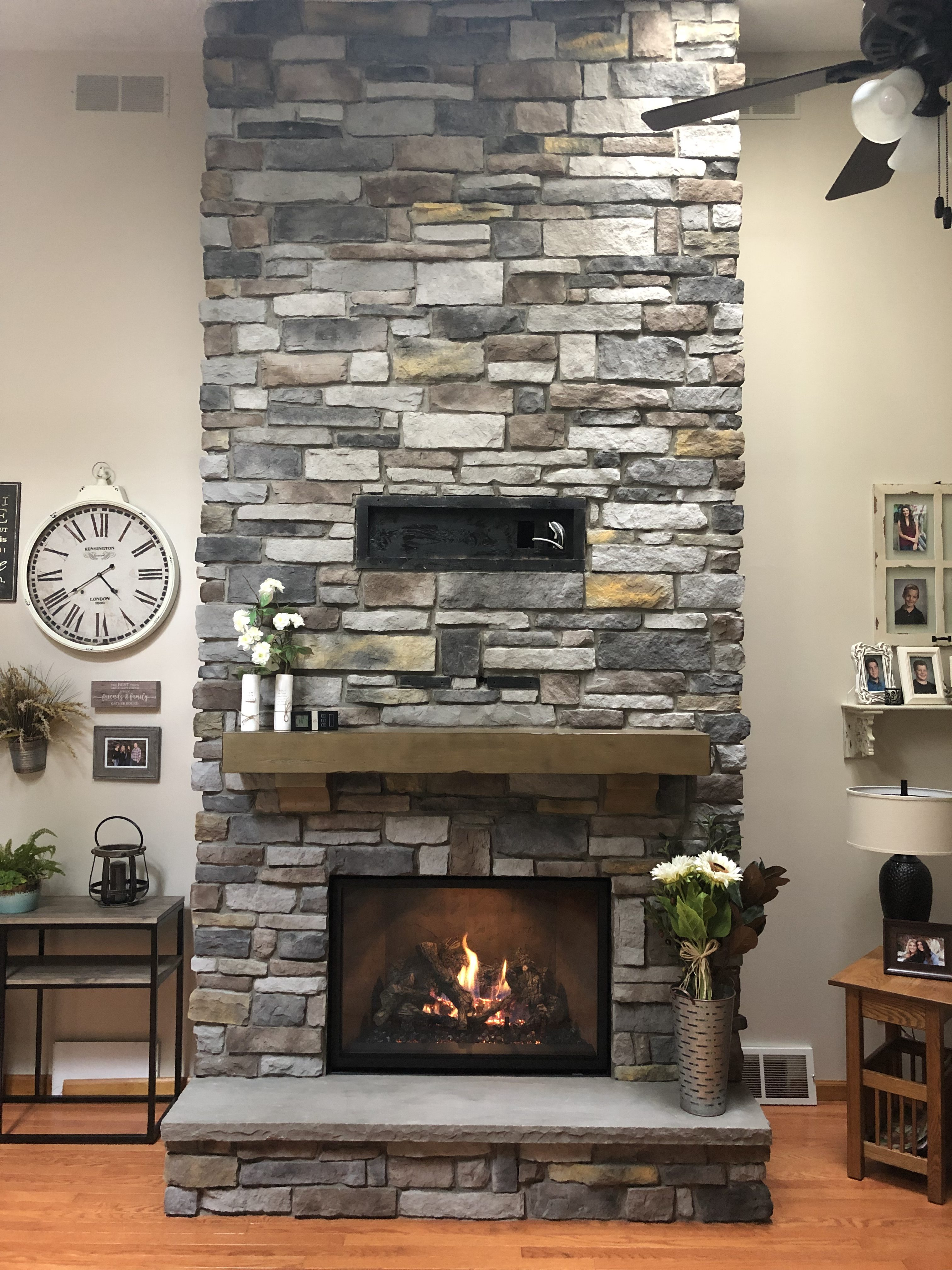 Image of a 864TRV 31KCF Gas fireplace by Travis Industries featuring Stucco interior and stone facing.