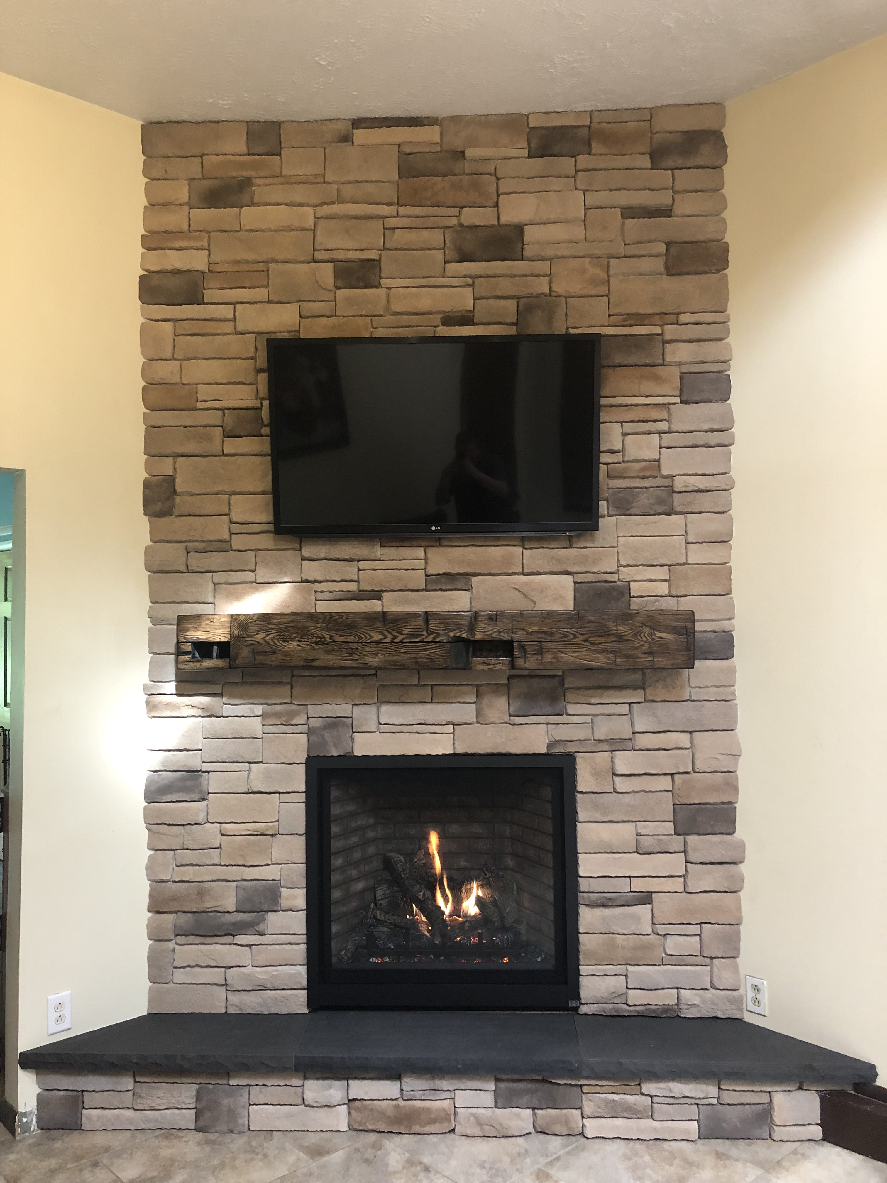 Image of a Probuilder 36CF Gas fireplace by Travis Industries featuring traditional brick interior.