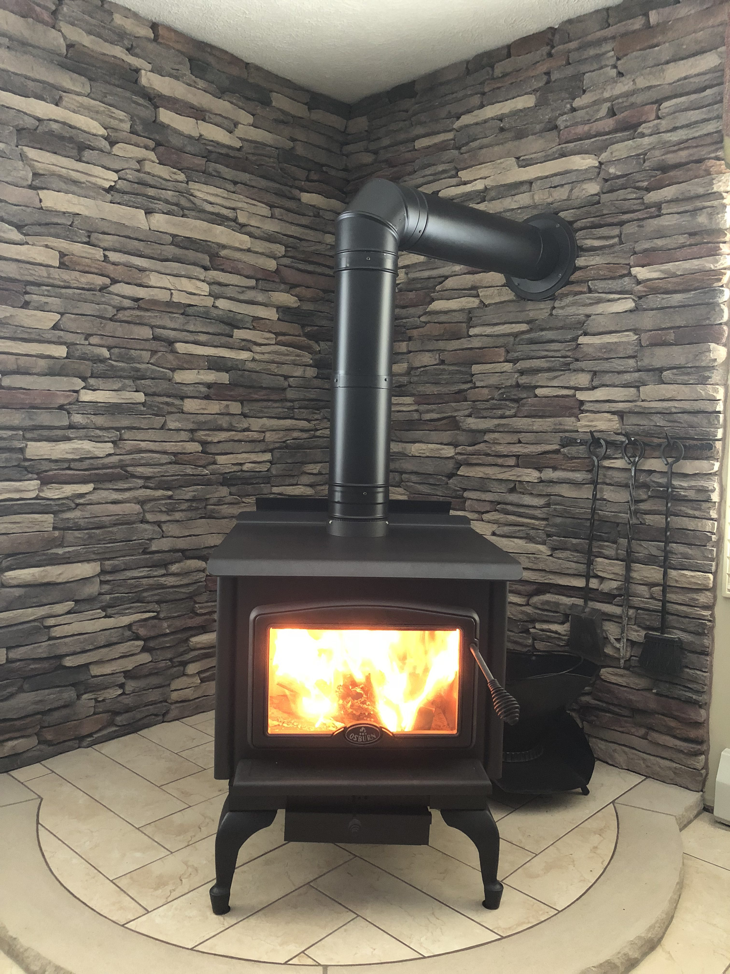 Image of a traditional 1600 Wood Stove by Osburn featuring stone hearth.